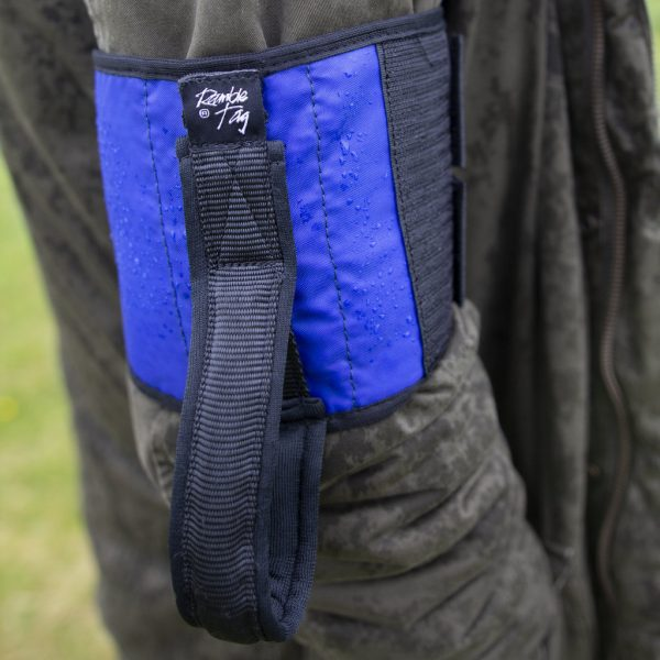 Blue original tag on upper arm of guide, with a black rim and black handle. raindrops sit on the surface.