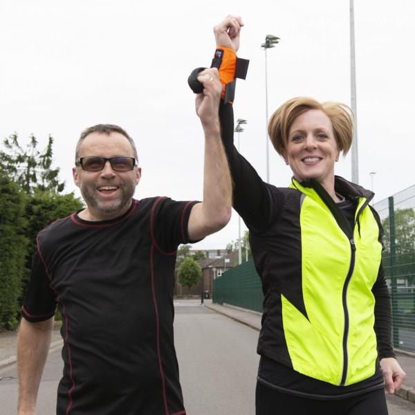 guide runner celebrating with blind runner