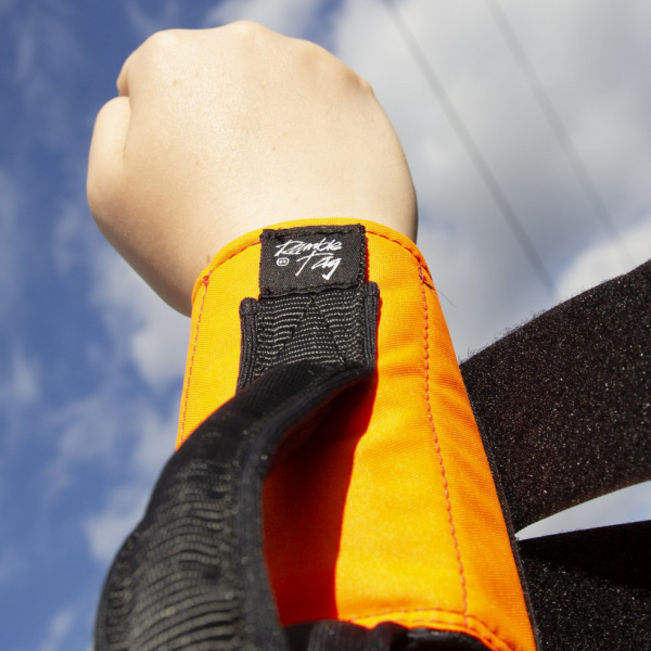 orange sport ramble tag on wrist of guide