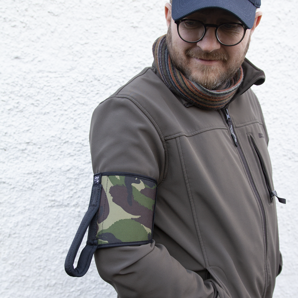 guide wearing the green and brown camouflage patterned ramble tag on his upper arm. it blends in with his cacky green jacket