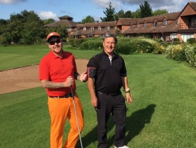 blind golfer with his guide